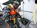 A Ugandan service member searches a target vessel during exercise Cutlass Express 2013 in the Gulf of Tadjoura off the coast of Djibouti Nov. 14, 2013 131114-F-NJ596-168.jpg