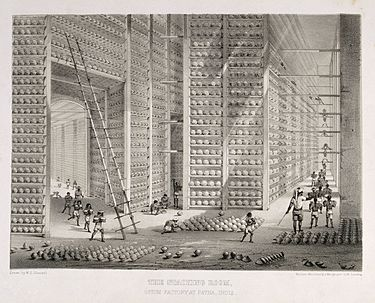 Storage of opium at a British East India Company warehouse in India A busy stacking room in the opium factory at Patna, India. L Wellcome V0019154.jpg