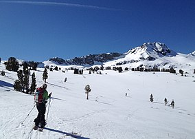 A skier heading towards RoundTop Peak.JPG
