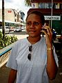 A young woman uses her mobile phone in Port Vila, Vanuatu, 2008. Photo- Rob Walker - AusAID (10664577515).jpg