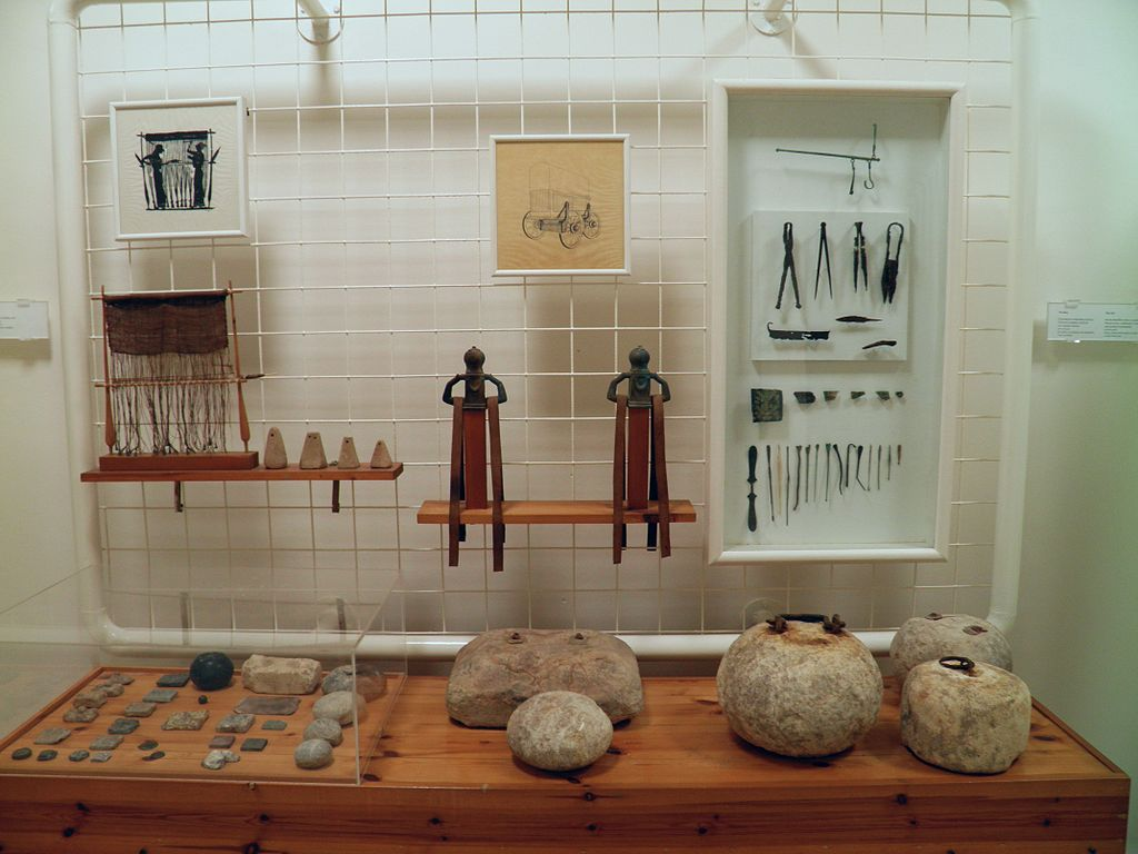 Accessories of clothing and beauty objects (in the showcase), metal and stone weights (on the bench), from the city, Archaeological Museum, Dion (7080677483)