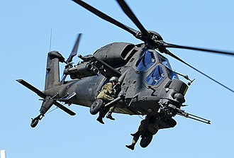 Agusta A129 Mangusta - An A129 in flight, with personnel riding on the landing gear