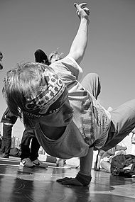 A black and white photograph of a Russian b-boy dancing in Moscow.