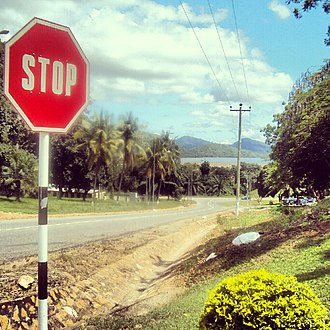Transport in Ghana - Dual Carriageway with a Stop Sign in Akosombo, Eastern region, Ghana.