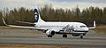 Alaska Air 737 on its takeoff roll at ANC (6193706475).jpg