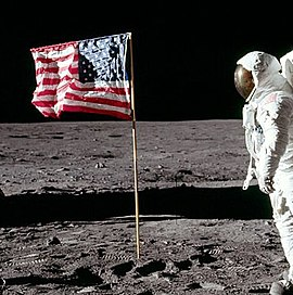 Cropped photo taken a few seconds later, Buzz  Aldrin's hand is down, head turned toward the camera, the flag is  unchanged.