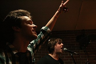 Alex Day - Alex Day performing in New York City at Gizzi's Coffee in 2010, with Eddplant
