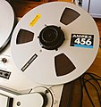 Ampex-branded 10-inch spool with magnetic tape (16264556524).jpg
