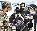 An ailing woman being carried for emergency medical aid in an armed forces medical camp in Jammu & Kashmir, on September 10, 2014.jpg