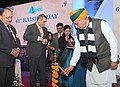 Arjun Ram Meghwal lighting the lamp at the 61st Annual Day of National Projects Construction Corporation Ltd. (NPCC), A PSU under the Ministry of WR, RD & GR, in New Delhi.jpg