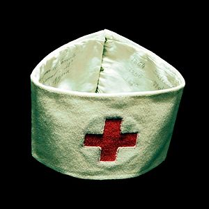 Louis Appia - Armband worn by Louis Appia on several battlefields, 1864, with dates and places written on the inside. On display at International Red Cross and Red Crescent Museum.