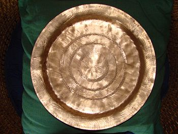A traditional brass metal dish from Assam.