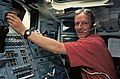 Astronaut Claude Nicollier at the Remote Manipulator System Controls on Aft Flight Deck (28049532641).jpg
