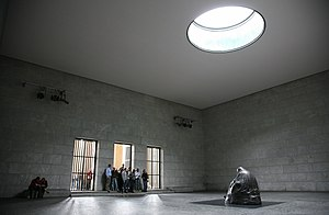Neue Wache - Inside post-reunification Neue Wache, showing the Käthe Kollwitz sculpture Mother with her Dead Son and the oculus, which exposes it to the elements