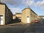 Back Charles Street, Waterloo Road, Brighouse With the bottom end of Lightcliffe Road on the right. These houses were built to fill the plot; there were no front gardens, and if roads met at an angle the end house was tapered.