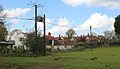 Back of Bridge Road houses from Cripsey Brook, Moreton village, Essex, England.jpg