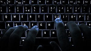 Hacker - The popular culture image is of a hacker operating in a darkened room