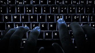 Hacker - The popular culture image is of a hacker operating in a darkened room, a viewpoint that is rarely accurate.