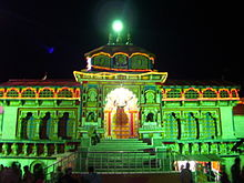image of the temple at night illuminated with green light