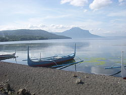Fishing boats on the shore of Taal Lake in Balete