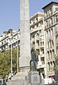 Barcelona - Passeig de Gràcia - View North on Cinc d'Oros - Obelisk & Statue by Frederic Marès dedicated to the Fascist victory of 1939 (Emblems have been removed in 1979).jpg