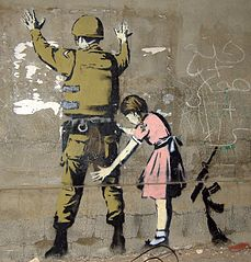 Banksy: Girl checking soldier