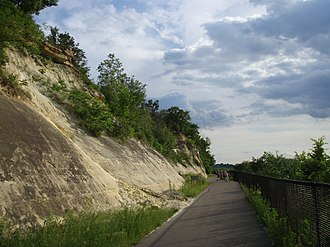Big Rivers Regional Trail - An outcropping of sandstone topped by limestone along the river bluffs.