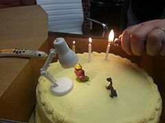 Birthday cake with Ganesh and toy lamp.jpg