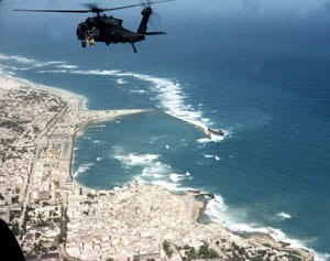 History of the United States (1991–2008) - An American helicopter flies over the Somalian coast during the Battle of Mogadishu, part of U.S. involvement in Somalia in the early 1990s.