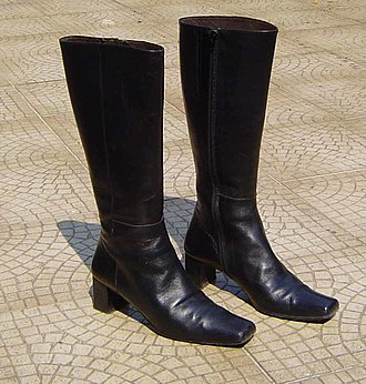 Boot fetishism - Typical pair of modern women's fashion boots in black leather.