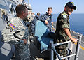 Brazilian military Gen. Floriano Peixoto, commander of United Nations Stabilization Mission in Haiti, visits USS Bataan (LHD 5) with U.S. Army Lt. Gen. P.K. Keen, deputy commander of U.S. Southern Command and 100311-N-HX866-023.jpg