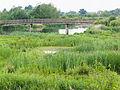 Bridge over marsh (14397794703).jpg