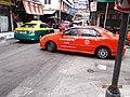 Brightly coloured taxi in Bangkok.jpg