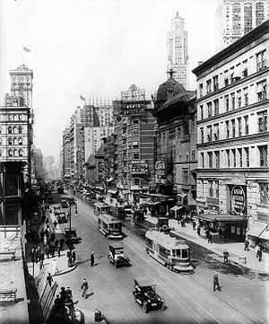 Casino Theatre (New York City) - Broadway, 1920, looking north from 38th Street, showing the Casino and Knickerbocker Theatres, a sign pointing to Maxine Elliott's Theatre, which is out of view on 39th Street, and a sign advertising the Winter Garden Theatre, which is out of view on 50th Street. All but the Winter Garden are demolished. The old Metropolitan Opera House and the old Times Tower are visible on the left.