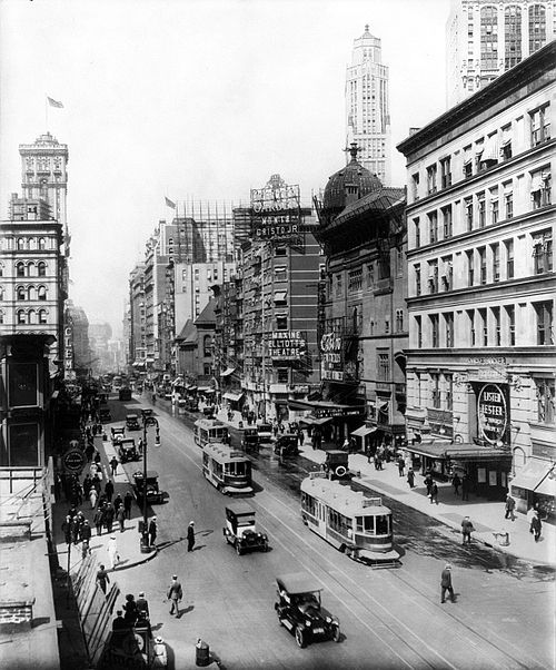 "Broadway north from 38th St., New York City, showing the Casino and Knickerbocker Theatres (""Listen, Lester"", visible at lower right, played the Knickerbocker from December 23, 1918, to August 16, 1919), a sign pointing to Maxine Elliott's Theatre, which is out of view on 39th Street, and a sign advertising the Winter Garden Theatre, which is out of view at 50th Street. All but the Winter Garden are demolished. The old Metropolitan Opera House and the old Times Tower are visible on the left. Broadway theatres 1920.jpg"