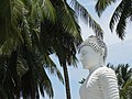 Buddha Sculpture with Palm Trees - New Town - Galle - Sri Lanka (14044336252).jpg