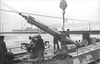 8.8 cm SK C/35 naval gun - The typically unshielded SK C/35 deck gun of a type VII U-boat is visible below the torpedo tail.