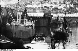 "Basis Nord - Former whaler ""Jan Wellem"" (left) ran aground after Battles of Narvik April 10–13, 1940 Narvik. Later it was salvaged."
