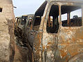 Burned trucks in Afghanistan.jpg