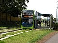 Bus on the Cambridgeshire Guided Busway, in Impington, Cambridgeshire, England.jpg