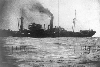 Tench-class submarine - Periscope photo of Japanese merchant ship sinking.