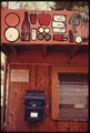 COUNTRY STORE WITH A PAINTED FRONT ADVERTISING ITEMS FOR SALE AT MALIBU LAKE IN THE SANTA MONICA MOUNTAINS NEAR... - NARA - 557567.tif