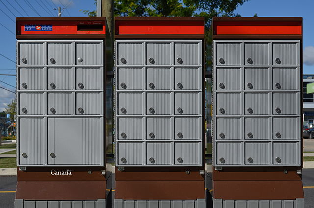 Canada Post Community Boxes By Raysonho @ Open Grid Scheduler / Grid Engine (Own work) [CC0], via Wikimedia Commons