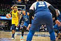 Cappie Pondexter (25) with the ball is guarded by Seimone Augustus (33) in the Lynx vs Fever game.jpg