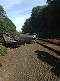 Car Flipped Near LIRR Tracks (29342958580).jpg