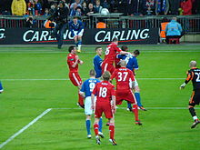 Liverpool and Cardiff players compete for the ball following a Cardiff throw-in.