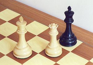 Checkmate - Black is checkmated—the game is over.