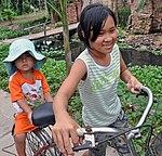 Children make their way by bicycle in Hung Yen village, Vietnam, where USAID works to fight avian influenza (5070815589).jpg