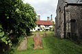 Church of Ss Mary & Lawrence - churchyard east cottage from west.JPG