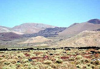 Coso Volcanic Field - A basaltic lava flow that is typical of the process that created the stepped terraces of Coso as it flowed across the landscape, producing a more or less flat surface eroding to a sheer front.